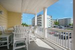 The Balcony off the Living Area is beautifully furnished with High-End Dining Furniture.