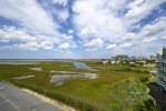 Enjoy sweeping Views of the Bay & Marsh from this Luxury Condo in OCMD.