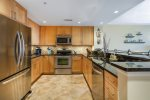 Gleaming Granite Countertops & High-end Stainless Appliances.