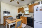 Enjoy all the comforts of Home in the well-stocked Kitchen that leads to the Screened Porch.