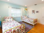 The second bedroom boasts two Twin beds and colorful design.