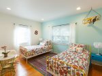 The second bedroom boasts two Twin beds and playful design.