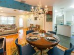 The convenient dining area is just off the kitchen and can comfortably accommodate 4-6 at a round table.