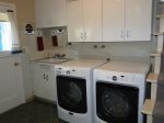 Living room has large screen TV and a gas fireplace