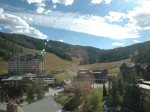 View from condo of the base area with ski lifts , ski runs & mountain village.