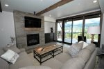 Open floor plan with stunning views of ski area and Lone Peak