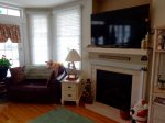 Large Screen TV and Fireplace