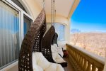 Comfortable swinging chairs to take in the view