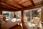 View of gardens from bed out 3 walls of glass don`t worry full floor to ceiling heavy curtains for sleeping