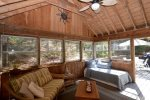 3 Season Porch with seating and daybed with trundle