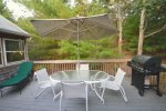 Large back deck with grill, large outdoor dining and chaise