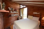 Upstairs queen bedroom with slider onto deck. Listen to the surf at night