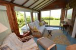 Sun room with beautiful views of Nauset Inlet and sliding doors to front yard