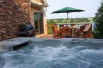 Hot tub and outdoor dining with water views