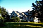 Aerial of house with views of Fort Hill, Nauset Marsh, Nauset Light and the Atlantic Ocean