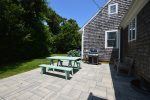 Back Patio with outdoor dining and grill safe from coastal wind