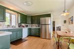 Full kitchen and stainless steel fridge