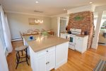 Bright, updated, fully-equipped kitchen with access to back patio