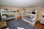 Spacious bunk room with two bunks, both with additional twin trundles