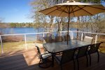 Outdoor water view dining for 8