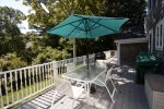 Large deck with stairs to lower level, gas grill, outdoor dining