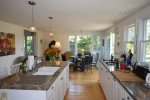 Large open kitchen with island, flat top stove, and dining area