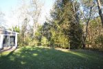 Spacious private and wooded back yard