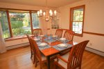 Dining room with large bay window and seating for 6