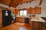 Large kitchen with beautiful wood cabinets