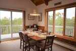 Dining area with views of nature and lots of light, access to deck