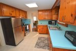 Sunny kitchen with access to back deck and brand new appliances