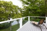 Brand new deck with views of the pond and outdoor furniture