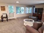 Lower living area with backyard access and water views. Flat screen TV, AC, new carpets and paint