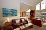 Lounge with beautiful views of the bay and gas fireplace for cooler nights