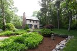 Carriage House exterior with beautiful landscaping