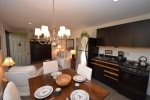 Carriage House living/ dining and kitchen with sliders to private deck