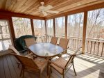 Main level screen porch with outdoor dining for 6