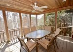 Screened porch on main level open on 3 sides, outdoor dining for 6