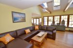 Spacious living room with sliders to deck and plenty of natural light