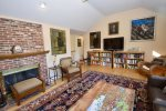 Main living area with flat screen TV, extensive reading library