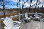 Back deck with adirondack seating - great spot to relax