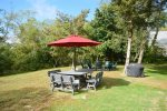 Large yard with fire pit and outdoor dining