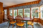 Cozy wood paneled dining room with access to the backyard