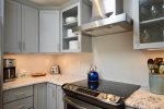Fully renovated kitchen with new stainless steel appliances and granite countertops