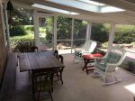 Screened sun porch with outdoor dining