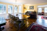 Stately dining room table and vintage piano