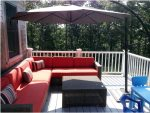 Back deck with seating and umbrella