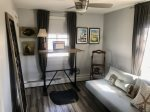 Upper level bedroom with futon, ceiling fan, AC. Sleeps 2.