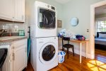 Main level laundry with new stacked washer and dryer