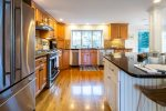 Beautiful, well-equipped kitchen with stainless steel appliances and wet bar.
